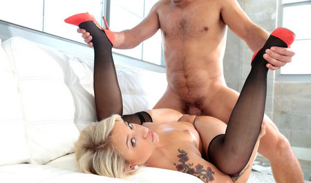Blonde milf giving a handjob